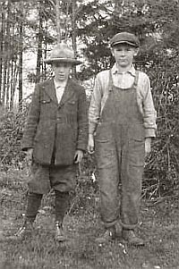 Young brothers Bob and Elton standing outside.
